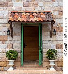 Wooden door with stone wall