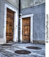 Wooden doors as seen from the street, Carouge city, Switzerland
