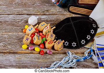 wooden dreidels spinning top for hanukkah jewish holiday