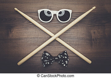 wooden drumsticks on wooden table - pair of wooden ...