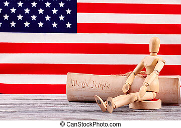 Wooden dummy and constitution of the USA.