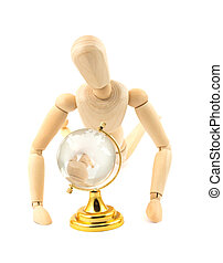 Wooden dummy and glass earth globe