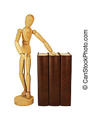 Wooden dummy and pile of old books