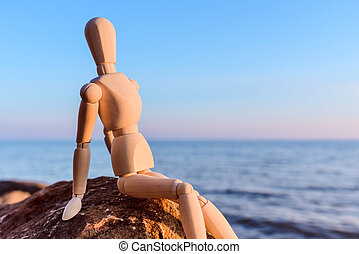 Wooden dummy at the sea