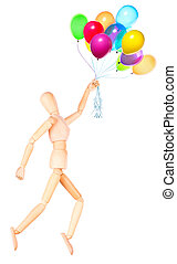 wooden Dummy holding flying balloons isolated