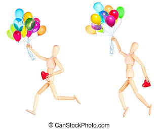wooden Dummy holding red heart and balloons