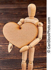 Wooden dummy mannequin with plywood heart.