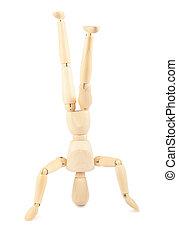 Wooden dummy standing on head