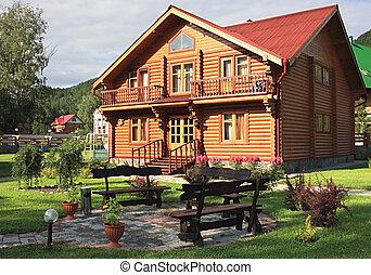 """Wooden dwelling-house. A tourist area """"Turquoise Katun""""...."""