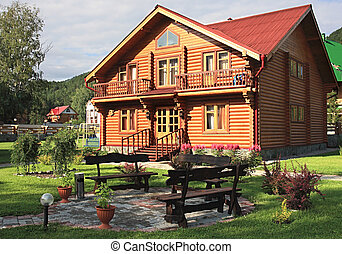 "Wooden dwelling-house. A tourist area ""Turquoise Katun"". Altai. Russia."