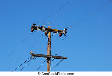 Wooden Electric Pole With Cables Going Diagonally Shown...