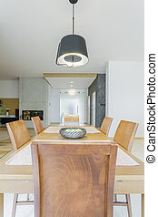 Wooden elegant dining table with chairs