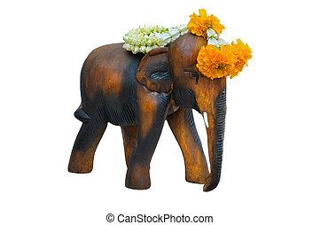 Wooden elephant with Jasmine Thai Garland isolate on white