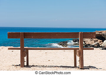Wooden empty bench with a majestic sea view
