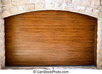 Wooden entrance in stone wall
