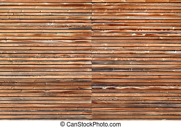 Brown wooden facade of a house with horizontal battens and silver screws in horizontal format