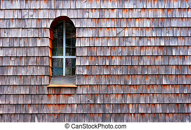 wooden facade - Wooden shingle facade with a tall window