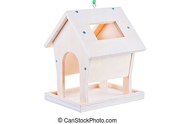 Wooden feeder for birds close-up on a white background
