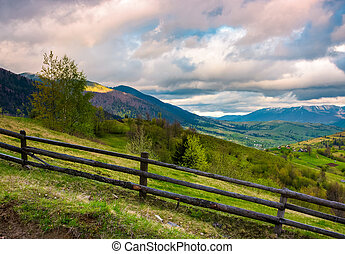 wooden fence across the hill. beautiful agriculture scenery...