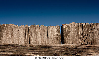 wooden fence against the blue sky