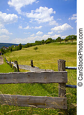 Agriculture landscape with wooden fence on a pasture, summer, Saarland / Germany