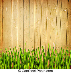 Wooden fence and green grass - Background with wooden fence ...