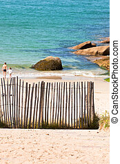 Wooden fence at Northern beach in France. Vertical shot