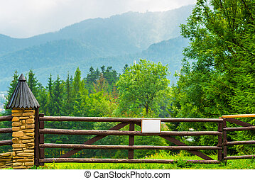 wooden fence, beautiful view of the mountains and forests