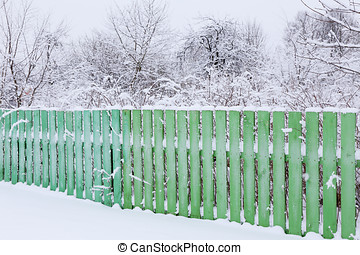 wooden fence enclosing a green garden