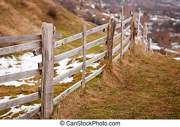 Wooden fence in the countryside
