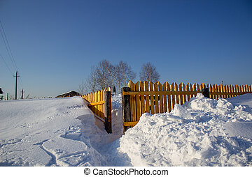 Wooden fence in the snow. Snow background