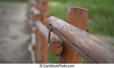 Wooden fence in the stable. Corral for horses