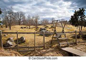 Wooden fence on a field in Sweden