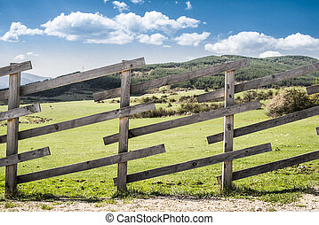Wooden fence on a mountain ranch