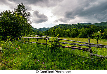 wooden fence on a rural meadow in mountains. lovely...