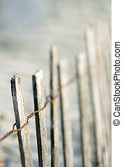 Wooden fence on beach.