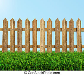 Wooden fence on grass