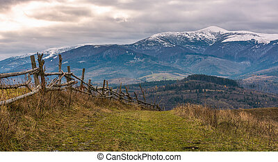 wooden fence on hills of mountainous countryside....