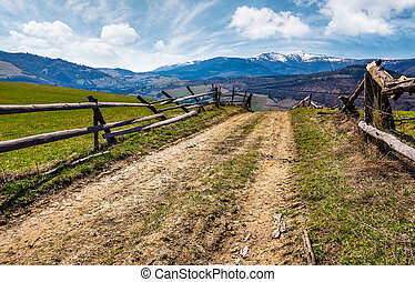 wooden fence on rural hill in spring