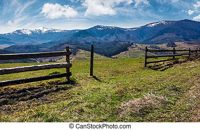 wooden fence on rural hill in spring. lovely mountainous...