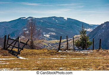 wooden fence on the edge of a hillside