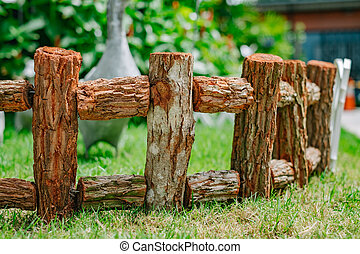 Wooden fence on the grasses