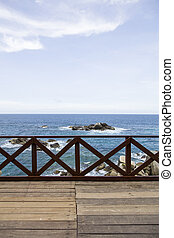 Wooden fence on the pier at Caribbean sea