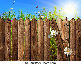 wooden fence over the courtyard with sky and sun