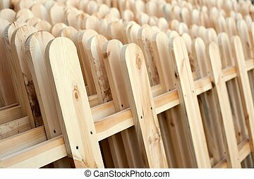 Several rows of new wooden fence