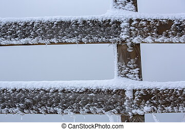 Wooden fence, snow and frost