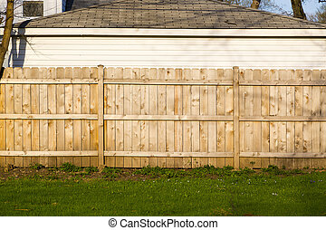 tall brown wooden property fence