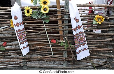 wooden fence (the fence)Ukrainian embroidered towel