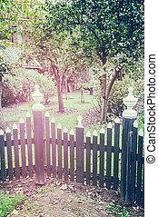 Wooden fence to backyard garden