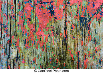 Wooden fence with peeling paint